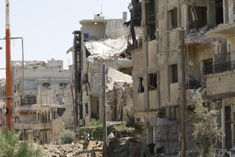 დანგრეული ქუჩის ხედი სირიის ქალაქ ალ-მეიაში, რომელიც სირიის ჯარებმა ტერორისტებისგან 14 აგვისტოს გაათავისუფლეს © EPA, 15.08.2014
