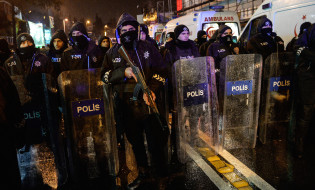 epa05693624 Turkish riot police officers secure the area after a gun attack on Reina, a popular night club in Istanbul, near by the Bosphorus, Turkey, 01 January 2017. At least 35 people were killed and 40 others were wounded in the attack, local media reported.  EPA/STR