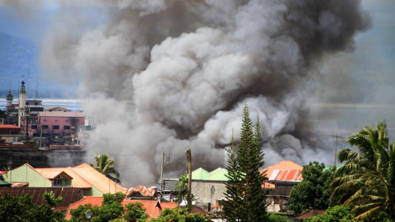 კვამლმოდებული სახლი სამხრეთის ქალაქ მარავიში, სადაც ომი მიმდინარეობს. 27.05.2017 credit: EPA/RICHEL V. UMEL