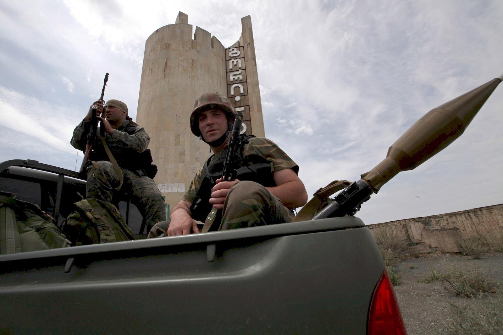 საქართველოს შეიარაღებული ძალები გორს ტოვებენ. ქალაქი რუსეთმა დაიკავა © EPA/PAVEL WOLBERG