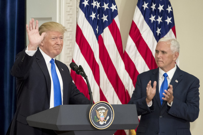 epa06096983 US President Donald J. Trump (L) delivers remarks beside US Vice President Mike Pence (R) during the first meeting of the Presidential Advisory Commission on Election Integrity, at the Eisenhower Executive Office Building (EEOB) on the White House complex in Washington, DC, USA, 19 July 2017.  EPA/MICHAEL REYNOLDS