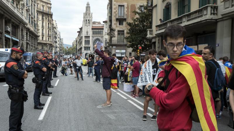 პოლიციის ძალადობის საპასუხოდ კატალონიაში გაიფიცნენ